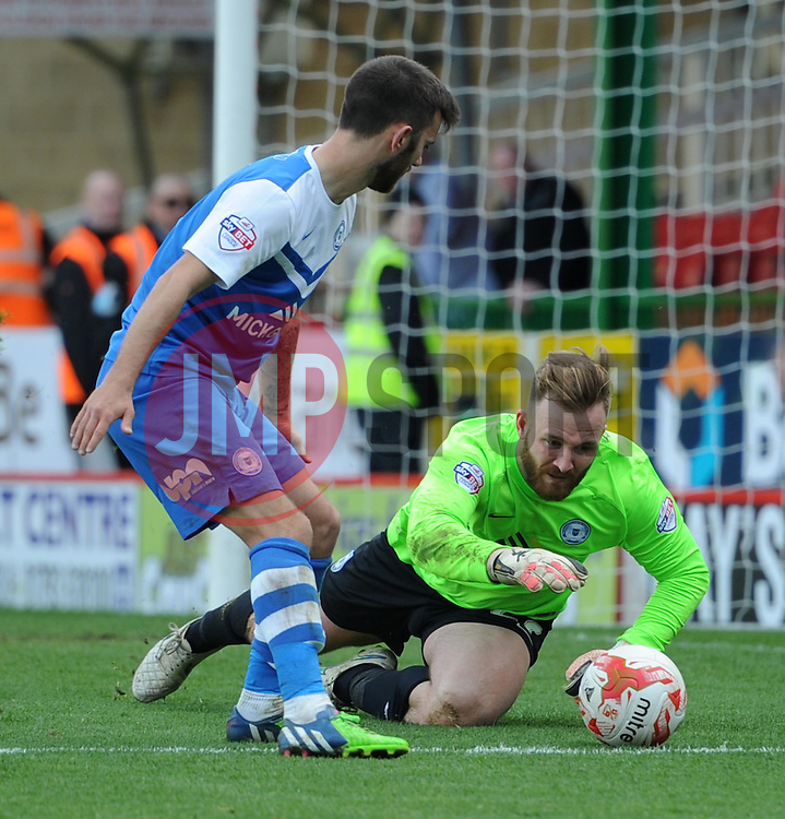 Peterborough United's Ben Alnwick scrambles to secure the ball - Photo mandatory by-line: Paul Knight/JMP - Mobile: 07966 386802 - 11/04/2015 - SPORT - Football - Swindon - The County Ground - Swindon Town v Peterborough United - Sky Bet League One