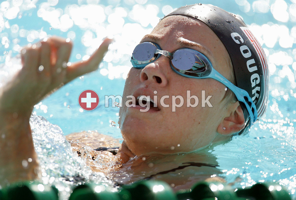 US swimmer Nathalie Coughlin gestures while swimming in the main pool at the Olympic Aquatic Center during a training session, Wednesday, 11 August, 2004. The games will start on August 13 with the opening ceremony in the Athens Olympic Stadium.  (Photo by Patrick B. Kraemer / MAGICPBK)