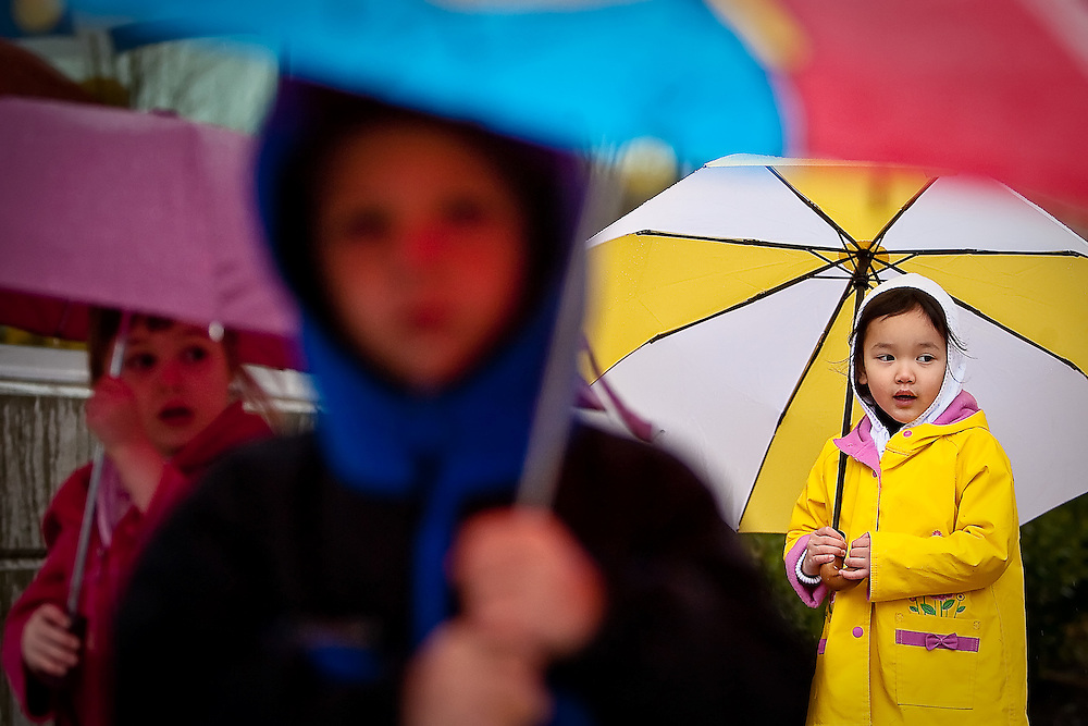 JEROME A. POLLOS/Press..Lei Anne Dribben, 4, walks to the Coeur d'Alene Library dressed for the weather Thursday behind her classmates from Glory Be Preschool Ashley Kerns, 3, left, and her brother Joshua Kerns, 5.