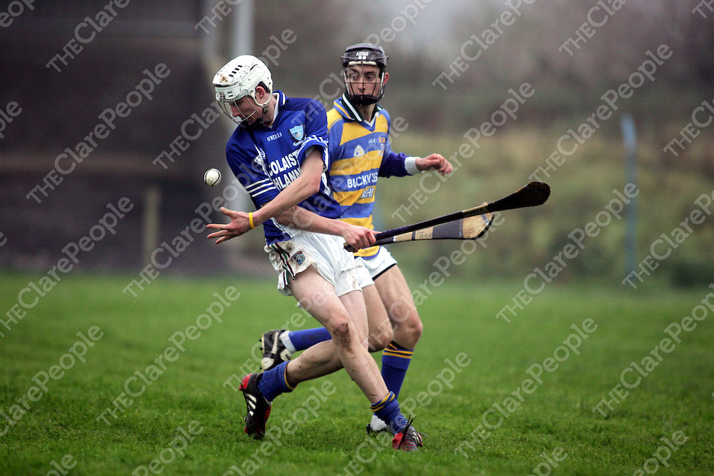 St Flannans Enda Barrett is closed down by Cashel's Eoin Butler in thier meeting in the Harty Cup in Caherconlish, Limerick on Wednesday. Pic. Brian Arthur/ Press 22.