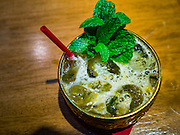 "27 JANUARY 2016 - BANGKOK, THAILAND: The ""Songkran"" a signature cocktail at Tep Bar, a new bar and restaurant in the Chinatown neighborhood of Bangkok, is made with Thai white spirits, fermented mixed herbs and honey.       PHOTO BY JACK KURTZ"