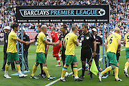 The Norwich players shake hands with the officials in front of a Premier League banner before the Barclays Premier League match at the DW Stadium, Wigan...Picture by Paul Chesterton/Focus Images Ltd. .07904 640267.13/8/11
