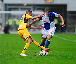 Bristol Rovers' Lee Brown is tackled by Newport County's Christian Jolley  - Photo mandatory by-line: Dougie Allward/JMP - Tel: Mobile: 07966 386802 17/08/2013 - SPORT - FOOTBALL - Rodney Parade - London - Newport County V Bristol Rovers - Sky Bet league two