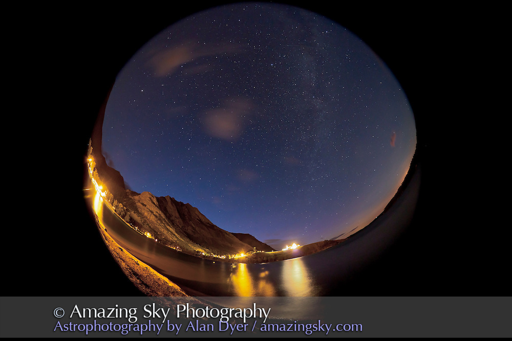 Stars and Milky Way over Waterton Hotel, Waterton Lakes National Park, July 20, 2011. This is one frame of 470+ frames taken for a time-lapse movie over 4 hours. This is a single 30-second exposure at f/4 with the Sigma 8mm lens at Canon 5D MkII at ISO 1600. The Moon is about to rise at right, giving a sky glow to the horizon while some deep blue twilight remains.