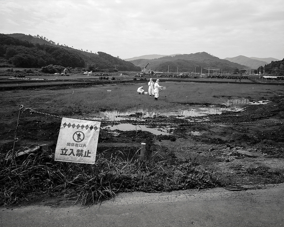 Decontamination of Rice field ,  Iitate Fukushima   testing the result of decontamination work july 2012 The government will start decontaminating residential zones in the least polluted area by the end of March 2013. It aims to complete the work by the spring of 2014 to prepare for the return of displaced Iitate residents. even though many experts believe it is a wast of resources since the area can never be truly decontaminated.Before the nuclear crisis started, Iitate had about 6,300 residents. Most of them now live in temporary homes in Fukushima city or elsewhere. <br /> <br /> <br /> All photos submitted are shot on 8x10 inch film and originals negs scanned for 30&quot;x40&quot; prints  at 300 dpi. <br /> <br /> <br /> All photos submitted are shot on 8x10 inch film and originals negs scanned for 30&quot;x40&quot; prints  at 300 dpi.pb@peterblakely.com  / +818010628306