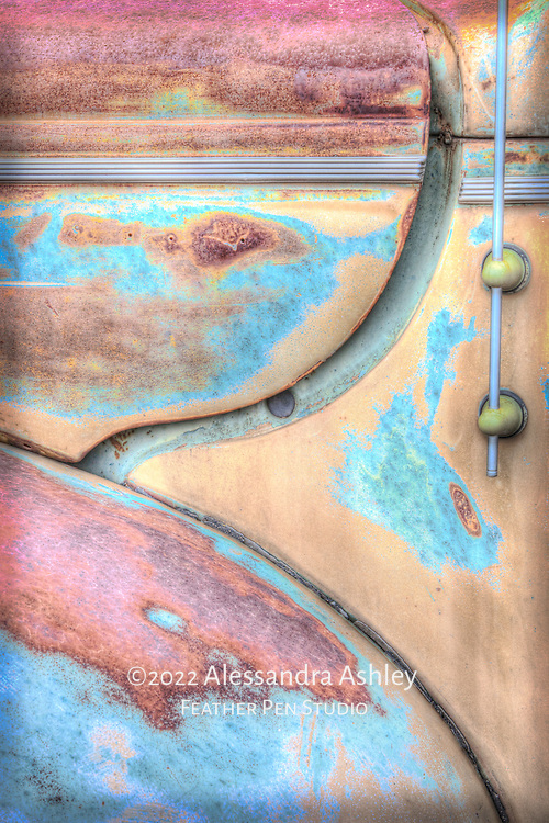 Antique truck detail, bright yellow-gold with rust, high dynamic range image.