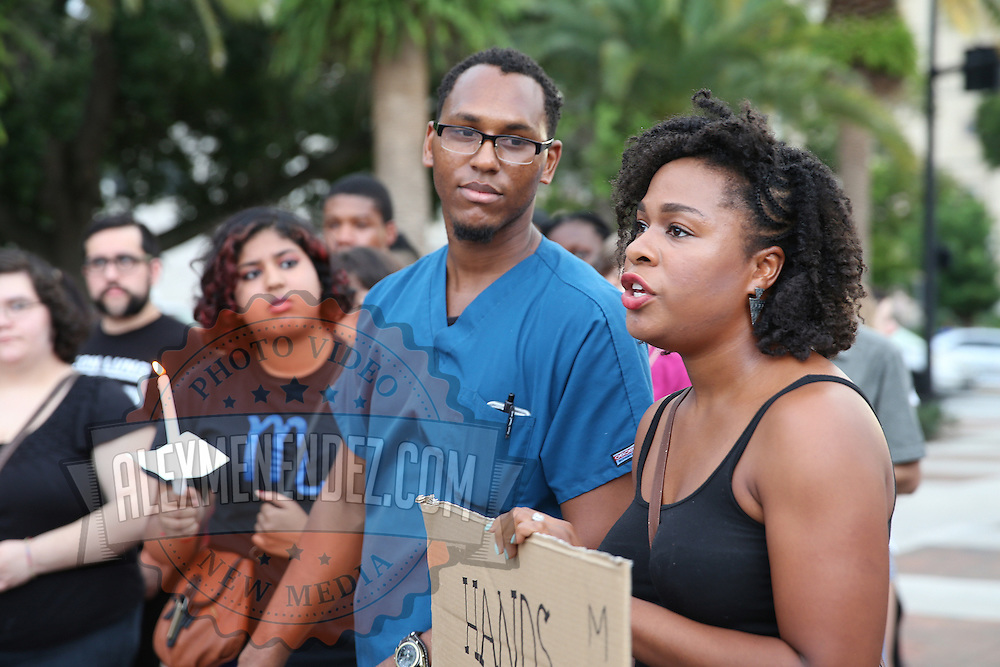"""Imani William speaks in Lake Eola park during the """"National Moment of Silence"""" event at the Lake Eola bandshell in downtown Orlando, Florida on Thursday, August 14, 2014. In light of the recent killing of eighteen year old Mike Brown in Ferguson, Missouri, citizens across America are gathering in solidarity to hold vigils and observe a moment of silence to honor victims of suspected police brutality. (AP Photo/Alex Menendez)"""