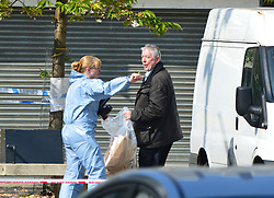 © Licensed to London News Pictures. 08/04/2017. London, UK. Police and forensics at the scene of a shooting in North Woolwich, east London, where a teenage boy was shot dead and a man in his 20s is in hospital with gunshot wounds.  Photo credit: Andrew Christy/LNP