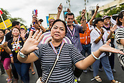 24 NOVEMBER 2013 - BANGKOK, THAILAND:     Anti-government protestors walk up Ratchdamnoen Ave in Bangkok. More than 400,000 people packed onto Ratchdamnoen Ave in Bangkok Sunday, continuing an anti-government protest that started weeks ago over a blanket amnesty bill passed by the Thai Parliament. The amnesty bill was defeated in the Thai Senate and the protest morphed into a general protest against the government. The protestors are allied with the Thai Democrat party, the opposition party in parliament. Tens of thousands of pro-government Red Shirts have come to Bangkok to defend the government and are rallying in a different part of the city. Police have warned of clashes between the two groups but as of Sunday evening no problems had been reported. The protestors allege that the amnesty would allow fugitive former Prime Minister Thaksin Shinawatra to return to Thailand.        PHOTO BY JACK KURTZ