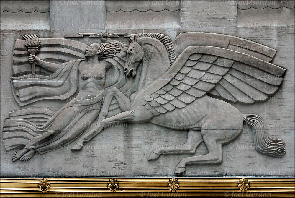 Three allegorical Art Deco bas-relief sculptures located north of the entrance to the Radio City Music Hall at 1270 6th Avenue in Manhattan.<br /> <br /> Panel on the right depicts a young man riding on the back of an eagle with his arms <br /> outstretched welcoming the rising sun.<br /> <br /> The central panel a woman wearing a  robe and holding a torch in her right hand and an <br /> electrical bolt  in her left hand. She is soaring with the mythological winged horse, Pegasus. <br /> <br /> The central panel a woman wearing a robe and holding a torch in her right hand and an <br /> electrical bolt in her left hand.<br /> <br /> The left panel has a female figure riding on a swan. Her left arm is bent upright and her right arm is straight back.