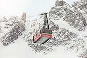 Get your ski trip off to a flying start! Cable car 9,000ft up in the French Alps turned into a luxury room for overnight stays<br /> <br /> A cable car suspended 8,858ft above the ground has been transformed into a luxury bedroom in one of the world's most popular ski resorts.<br /> Ski lovers are being offered the chance to spend the night in a Saulire cable car in Courchevel, France.<br /> The hotel room, which offers guests the perfect location to hit the slopes the next morning, is being offered by accommodation website Airbnb.<br /> <br /> Perhaps unsurprisingly, the company say that the cable car, which is being equipped with a bed and a living room, is there highest ever European listing.<br /> However, the room is available for just one night only and will be offered as part of a competition.<br /> Guests are being invited to submit an application to Airbnb explaining why they want to spend a night in the Saulire cable car. All entried must have been received before midnight on the 26th February.<br /> The winning entry will be able to take three guests to the cable car on 6th March, which will be completely transformed in just a matter of hours after a day of skiing.<br /> <br /> <br /> After climbing the ski runs by snowmobile, the four guests will be greeted with traditional mulled wine at the Saulire Summit.<br /> Suspended over the Combe de Saulire, highly prized by the best freeriders, the guests will be served a typical savoyard dinner of cheese fondue.<br /> They will then tuck in for the night at the very top of the Saulire, the highest point of Courchevel.<br /> In the morning, they will have the privilege of laying down the 'first tracks' over an untouched snow run.<br /> Adeline Roux, Director of Courchevel Tourism, said: 'We are happy to offer a unique experience of the mountain to four lucky winners who will discover Courchevel from an unprecedented angle!<br /> 'We thrive on challenge and take pride in opening up new possibilities.'<br /> <br /> <br /> James McClure, General Manager UK & Ireland at Airbnb, added: 'Travellers who choose Airbnb are