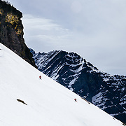 Lynsey Dyer and David Steele party skiing a ridgeline in Glacier National Park.
