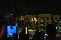 """ROME, ITALY - 27 JUNE 2017: (L-R) Opera singer  Veronica Marini (in the role of Donna Anna) is seen here on stage performing in the """"Don Giovanni OperaCamion"""", an open-air opera performed on a truck in San Basilio, a suburb in Rome, Italy, on June 27th 2017.<br /> <br /> Director Fabio Cherstich's idae of an """"opera truck"""" was conceived as a way of bringing the musical theatre to a new, mixed, non elitist public, and have it perceived as a moment of cultural sharing, intelligent entertainment and no longer as an inaccessible and costly event. The truck becomes a stage that goes from square to square with its orchestra and its company of singers in Rome. <br /> <br /> """"Don Giovanni Opera Camion"""", after """"Don Giovanni"""" by Wolfgang Amadeus Mozart is a new production by the Teatro dell'Opera di Roma, conceived and directed by Fabio Cherstich. Set, videos and costumes by Gianluigi Toccafondo. The Youth Orchestra of the Teatro dell'Opera di Roma is conducted by Carlo Donadio."""