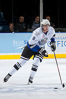 KELOWNA, CANADA - SEPTEMBER 28:  Trent Lofthouse #8 of the Victoria Royals skates on the ice with the puck at the Kelowna Rockets on September 28, 2013 at Prospera Place in Kelowna, British Columbia, Canada (Photo by Marissa Baecker/Shoot the Breeze) *** Local Caption ***