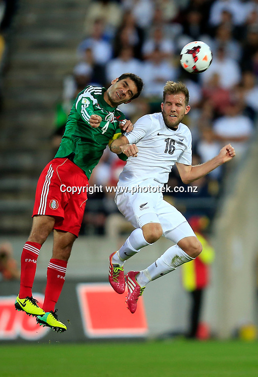 All Whites Jeremy Brockie goes up against Mexico's Rafael Marquez in action during the FIFA Football World <br /> Cup Qualifier 2nd Leg match. New Zealand All <br /> Whites v Mexico, Wellington, New Zealand. <br /> Wednesday 20 November 2013. Photo: Shane Wenzlick