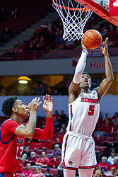 NORMAL, IL - December 18: Keith Fisher III wit a put back watched by defender Jordan Blount during a college basketball game between the ISU Redbirds and the UIC Flames on December 18 2019 at Redbird Arena in Normal, IL. (Photo by Alan Look)