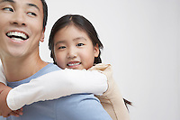 Young Girl Getting Piggyback Ride with Father close-up