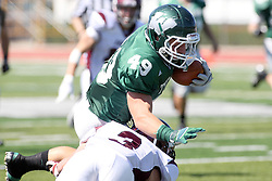 08 September 2012:  Cameron Blossom breaks free and runs for significant yardage before being stopped by Andrew Funsch during an NCAA division 3 football game between the Alma Scots and the Illinois Wesleyan Titans which the Titans won 53 - 7 in Tucci Stadium on Wilder Field, Bloomington IL