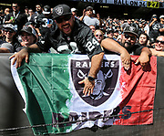 Sep 30, 2018; Oakland, CA, USA;  Oakland fans celebrate Hispanic Heritage Month during a game between the Oakland Raiders and the Cleveland Browns. The Raiders defeated the Browns 45-42 in overtime. Mandatory Credit: Spencer Allen-Image of Sport