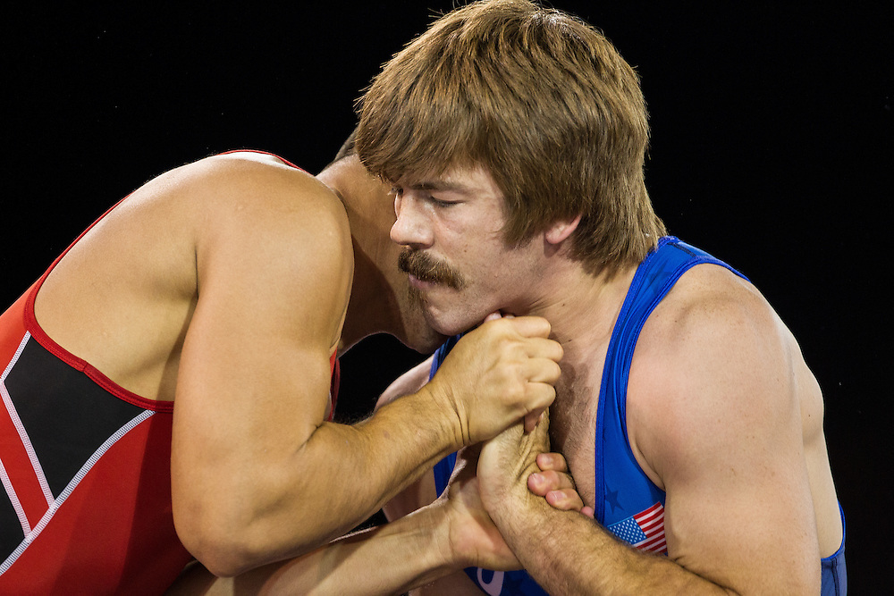 Andrew Bisek (R) of the United States struggles with Alvis Almendra of Panama during their gold medal match in the 75kg class of the men's greco-roman wrestling at the 2015 Pan American Games in Toronto, Canada, July 15,  2015.  AFP PHOTO/GEOFF ROBINS