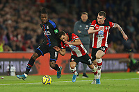 Football - 2019 / 2020 Premier League - Southampton vs. Crystal Palace<br /> <br /> Southampton's Cedric Soares falls into Wilfried Zaha of Crystal Palace whilst trying to win the ball during the Premier League match at St Mary's Stadium Southampton <br /> <br /> COLORSPORT/SHAUN BOGGUST