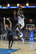 Nov 15, 2017; Los Angeles, CA, USA; UCLA Bruins guard Aaron Holiday (3) shoots the ball as Central Arkansas Bears guard Deandre Jones (55) defends during a NCAA basketball at Pauley Pavilion. UCLA defeated Central Arkansas 106-101 in overtime.