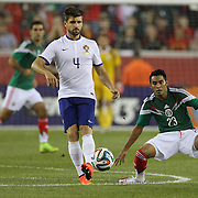 Miguel Veloso, (left), Portugal, watched by Jose Vazquez, Mexico, during the Portugal V Mexico International Friendly match in preparation for the 2014 FIFA World Cup in Brazil. Gillette Stadium, Boston (Foxborough), Massachusetts, USA. 6th June 2014. Photo Tim Clayton