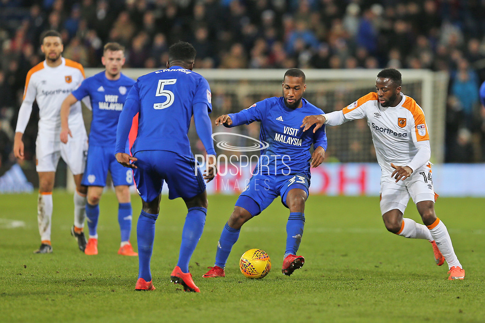 Cardiff City  Junior Hoilett (33) battles for the ball against  Hull City Adama Diomande (14) during the EFL Sky Bet Championship match between Cardiff City and Hull City at the Cardiff City Stadium, Cardiff, Wales on 16 December 2017. Photo by Gary Learmonth.