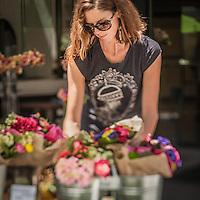 Flower seller near the Grand Lake Saturday Market, Oakland, CA