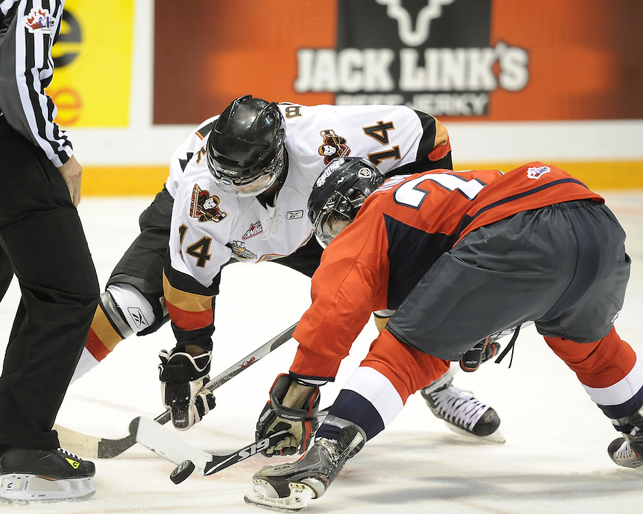 Scott Timmins of the Windsor Spitfires and Jimmy Bubnick of the Calgary Hitmen face off in Game 4 of the 2010 MasterCard Memorial Cup in Brandon, MB on Monday May 17. Photo by Aaron Bell/CHL Images