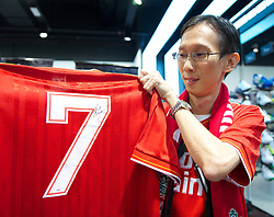 KUALA LUMPUR, MALAYSIA - Friday, July 15, 2011: A Liverpool supporter with a signed Kenny Dalglish shirt during a promotional event at the Adidas store at the Mid Valley Shopping Centre on day five of the club's Asia Tour. (Photo by David Rawcliffe/Propaganda)