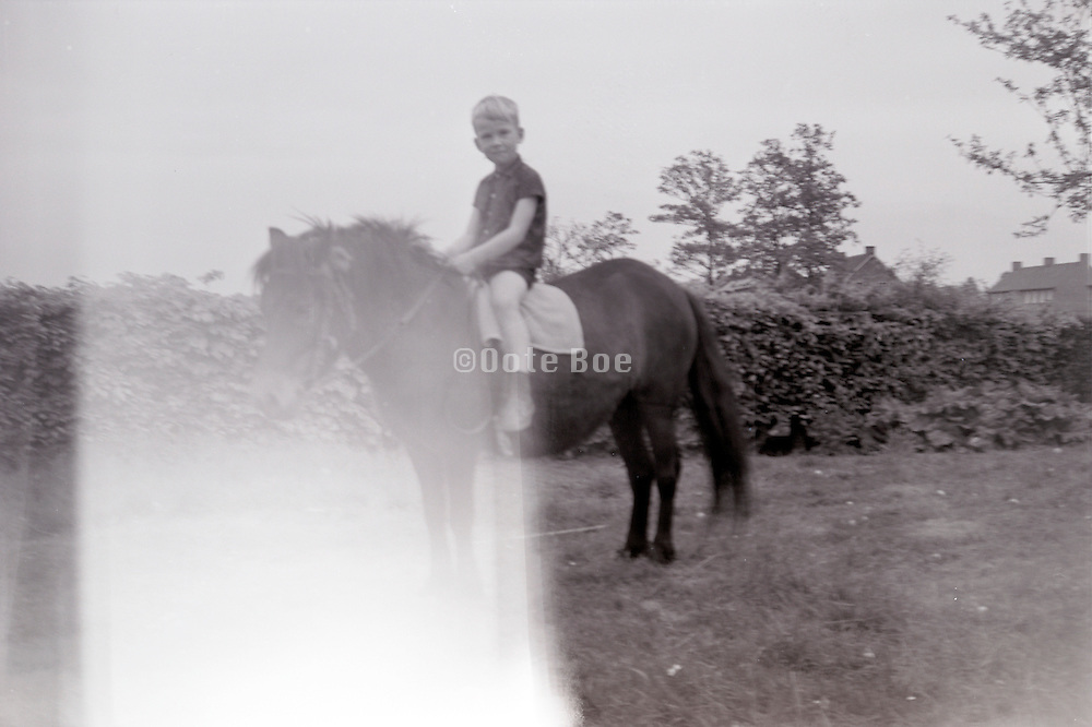 fading image of boy on a pony 1960s