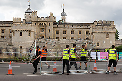© Licensed to London News Pictures. 07/07/2014. London, UK. Barriers are put into place near the Tower of London as roads are closed in preparation for the Tour de France Stage 3 in London today. Photo credit : Vickie Flores/LNP