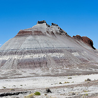 Photographs within Petrified Forest National Park. These conical hills are beds of soft mudstone in the Chinle Formation the central part of the Park.