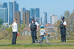 ©Licensed to London News Pictures 14/04/2020  <br /> Greenwich, UK. Two police officers on patrol talking to a young boy. Sunny weather in Greenwich park, Greenwich, London as people get out of the house from coronavirus lockdown to exercise. Photo credit:Grant Falvey/LNP