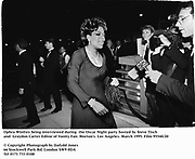 Ophra Winfrey being interviewed during  the Oscar Night party hosted by Steve Tisch and  Graydon Carter Editor of Vanity Fair. Morton's. Los Angeles. March 1995. Film 95540/20<br />