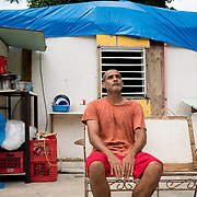AUGUST 27, 2018--PATILLAS---PUERTO RICO--<br /> Reinaldo Rivera Rivera, 44, sits in the roofless house he shares with his three young sons in Patillas. Rivera says a church group will help re build his house in October.<br /> (Photo by Angel Valentin/Freelance)