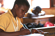 Students learning in a classroom at Tonga Junior High School, Ghana.