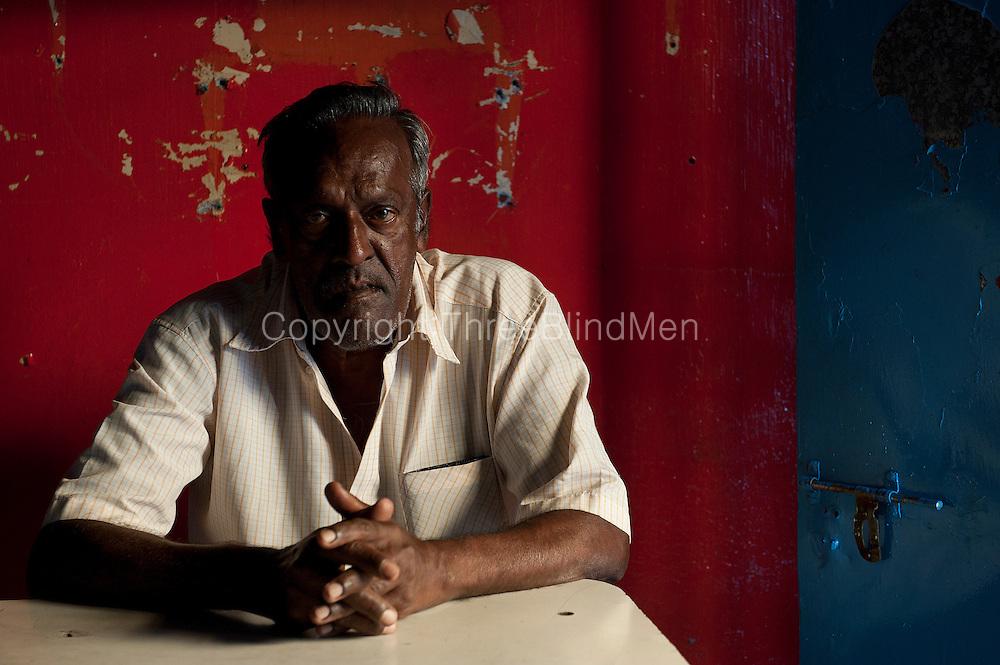 Mauritius. Mr. Nava Ramasomy works at the Taton bar in Port Louis.
