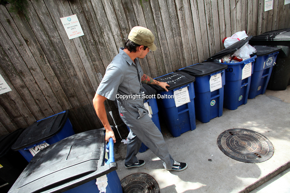 David Fernandez of Little Joy Recycling picks up the recyclable material from Ruggles Green restaurant in Houston, TX on Wednesday, August 19, 2009. Ruggles Green is considered Houston's first green certified restaurant. (Photo/Scott Dalton)