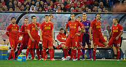 MELBOURNE, AUSTRALIA - Wednesday, July 24, 2013: Liverpool prepare to bring on nine substitutes, including Luis Suarez, against Melbourne Victory during a preseason friendly match at the Melbourne Cricket Ground. (Pic by David Rawcliffe/Propaganda)