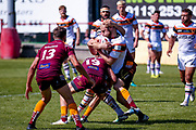 Bradford Bulls Damian Sironen (10) is tackled during the Kingstone Press Championship match between Batley Bulldogs and Bradford Bulls at the Fox's Biscuits Stadium, Batley, United Kingdom on 16 July 2017. Photo by Simon Davies.