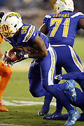 San Diego Chargers linebacker Korey Toomer (56) runs with the ball after recovering a third quarter fumble on a play that gives the Chargers a first down at the Denver Broncos 20 yard line during the 2016 NFL week 6 regular season football game against the Denver Broncos on Thursday, Oct. 13, 2016 in San Diego. The Chargers won the game 21-13. (©Paul Anthony Spinelli)