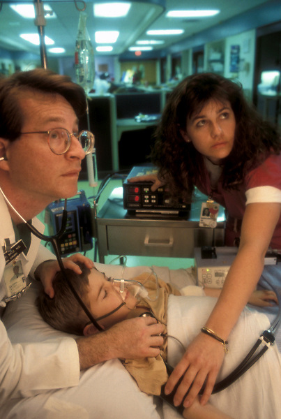 Stock photo of an emergency doctor and nurse tending to a young patient.