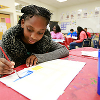 Thomas Wells | BUY AT PHOTOS.DJOURNAL.COM<br /> Milam Elementary School student Sabrina Robertson, 12, works on her hard edge line painting art project on Thursday as part of a whole arts initiative being put on artist Tony Davenport.