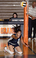 Middletown, N.Y. - A Dutchess Community College player makes a one-handed return from her knees against SUNY Orange in a women's volleyball match on Oct. 11, 2007.