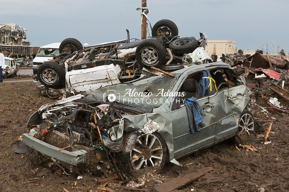 A tornado leaves behind damage cars in Moore, Okla. on Monday, May 20, 2013. (Photo/Alonzo Adams)