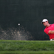 Rory McIlroy plays out of the sand trap on the 13th hole during the first round of theThe Barclays Golf Tournament at The Ridgewood Country Club, Paramus, New Jersey, USA. 21st August 2014. Photo Tim Clayton