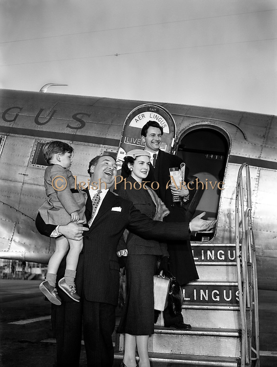 "Josef Locke, Radio and Stage Star, arriving at Collinstown Airport for Radio Review.24/03/1955..Josef Locke was the stage name of Joseph McLaughlin (23 March 1917 - 15 October 1999), a tenor singer who was successful in the United Kingdom and Ireland in the 1940s and 1950s..Born in Derry, he was the son of a butcher and cattle dealer, and one of nine children. He started singing in local churches in the Bogside at the age of seven, and as a teenager added two years to his age to enlist in the Irish Guards, later serving abroad with the Palestine Police Force, before returning in the late 1930s to join the Royal Ulster Constabulary. Known as The Singing Bobby, he became a local celebrity before starting to work the UK variety circuit, where he played 19 seasons in the northern English seaside resort of Blackpool. The renowned Irish tenor John McCormack (1884-1945) advised him that his voice was better suited to a lighter repertoire than the operatic one he had in mind, and urged him to find an agent?thus he found the noted impresario Jack Hylton (1892-1965) who booked him, but couldn't fit his full name on the bill, thus Joseph McLaughlin became Josef Locke..He made his first radio broadcast in 1949, and subsequently appeared on TV programmes such as Rooftop Rendezvous, Top of the Town, All-star Bill and The Frankie Howerd Show. He was signed to the Columbia label in 1947, and his first releases were the two Italian songs ""Santa Lucia"" and ""Come Back to Sorrento""."