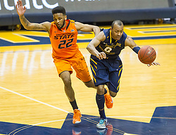 West Virginia Mountaineers guard Jevon Carter (2) tries to get past half court against the Oklahoma State Cowboys during the second half at the WVU Coliseum.